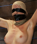 Pantyhose over head, tightly gagged and blindfolded