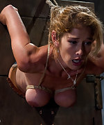 Hard bodied slut gets roped, tits pegged and whipped