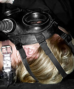Dia Zerva in tight rubber gas mask breathplay bondage