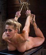 Painfully suspended and hogtied with hair to ass hook