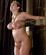 Buxom beauty roped, chained, clamped and fucked