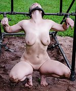 Stripped naked and restrained outdoors