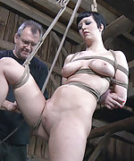 Cherry is strung up in a rough strappado