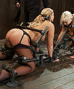Two blondes locked in a custom metal device