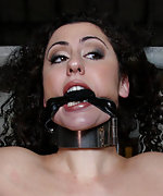 Princess Donna whipped in severe leather and metal bondage