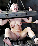 Cuffed, fixed with stocks, caned and dildoed